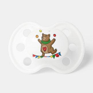 Bear juggling pacifier