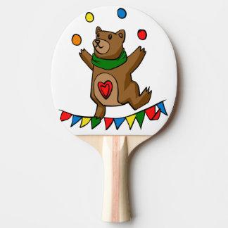 Bear juggling ping pong paddle