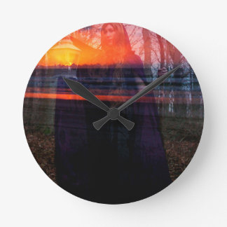 BEARER OF EVENING'S LIGHT ROUND CLOCK