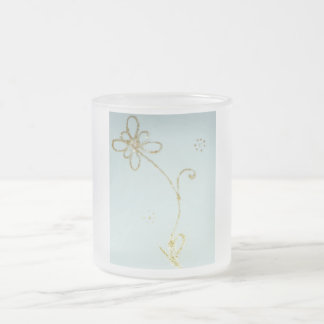 Beatyful frosty mug with golden flower pattern