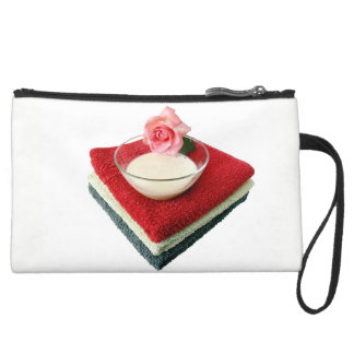 beautician with a rose motif suede wristlet