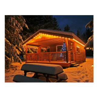 Beautiful Christmas Lights on Log Cabin in Snow Postcard