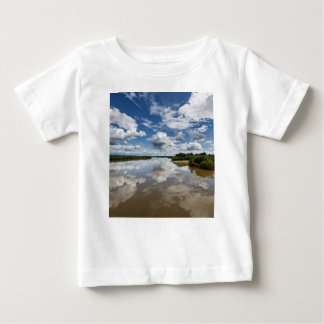 Beautiful clouds over river, reflection in water baby T-Shirt