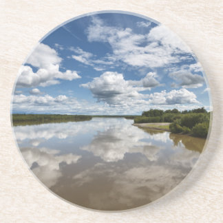 Beautiful clouds over river, reflection in water beverage coaster