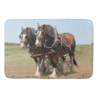 Beautiful clydesdale horses ploughing bath mat