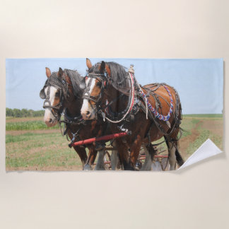 Beautiful clydesdale horses ploughing beach towel