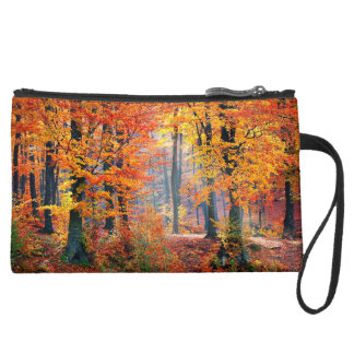 Beautiful colorful autumn forest sunbeams wristlet clutches