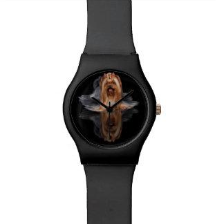 Beautiful dog on black reflecting background wristwatches