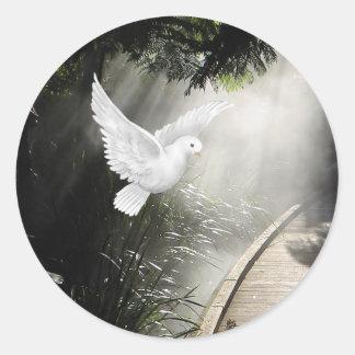 Beautiful flying dove in sunbeam classic round sticker