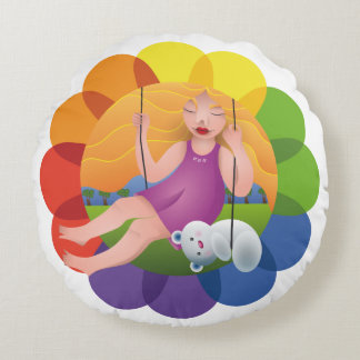 Beautiful girl in swing with its bear round pillow