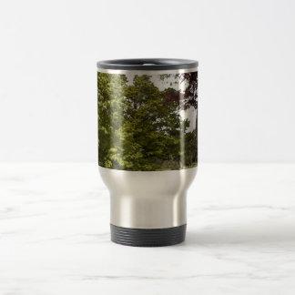 Beautiful green tree botanical garden. travel mug
