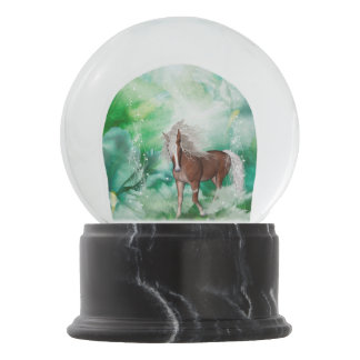 Beautiful horse in wonderland snow globe