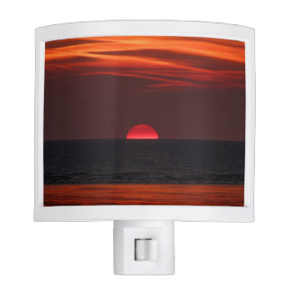 Beautiful image of the sun setting over the water night light
