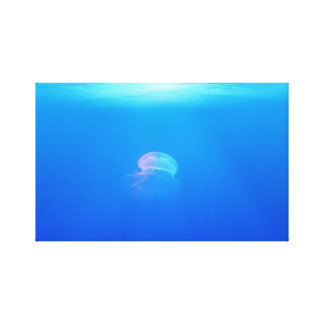 Beautiful Iridescent Jellyfish in a Sea of Blue Canvas Print