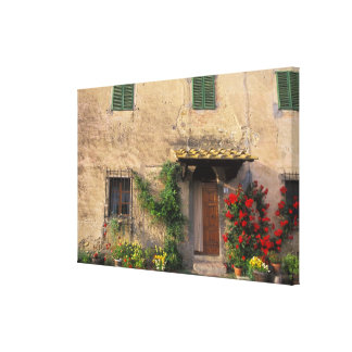 Beautiful old home with flowers at San Gimignano Stretched Canvas Print