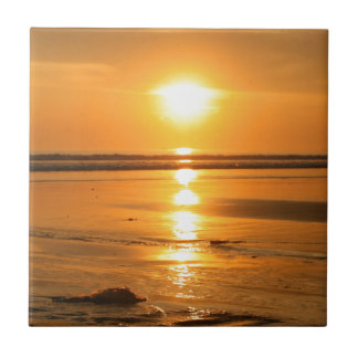 Beautiful orange sunset at the beach in Bali Tile