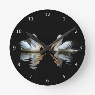 Beautiful pelicans reflected on black water, gift round clock