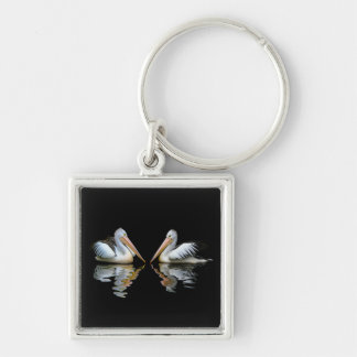 Beautiful Pelicans reflection on black background Keychain