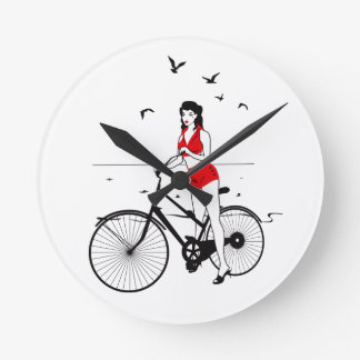 Beautiful pin-up girl on bicycle. Elegant stylish Clocks