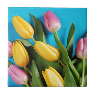 Beautiful pink and yellow spring tulips tile