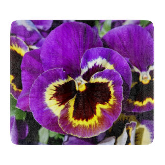 Beautiful purple pansy flower cutting board