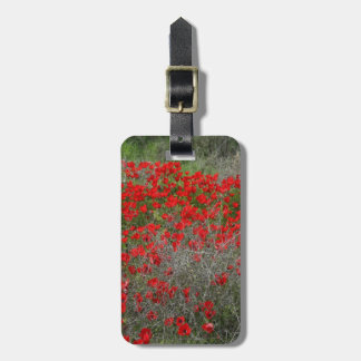 Beautiful Red Anemone Flowers In A Spring Field Luggage Tag