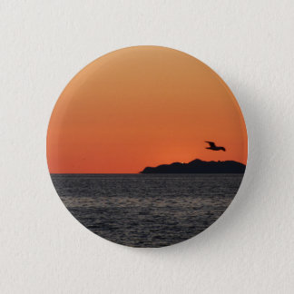 Beautiful sea sunset with island silhouette 2 inch round button