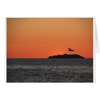 Beautiful sea sunset with island silhouette card