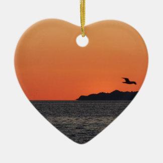 Beautiful sea sunset with island silhouette ceramic ornament