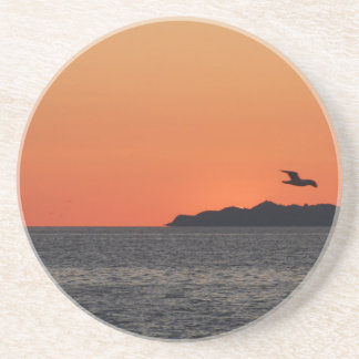 Beautiful sea sunset with island silhouette coaster