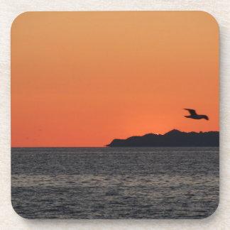 Beautiful sea sunset with island silhouette coaster