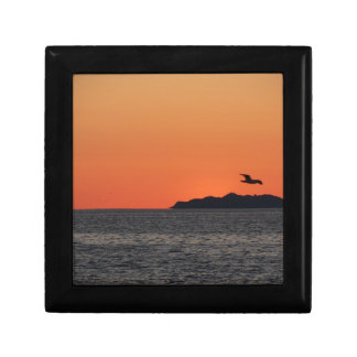 Beautiful sea sunset with island silhouette gift box