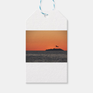 Beautiful sea sunset with island silhouette gift tags