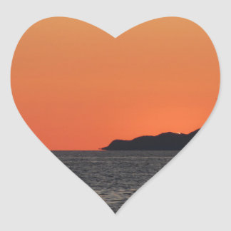 Beautiful sea sunset with island silhouette heart sticker