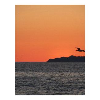 Beautiful sea sunset with island silhouette letterhead