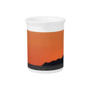 Beautiful sea sunset with island silhouette pitcher
