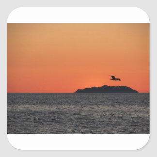 Beautiful sea sunset with island silhouette square sticker