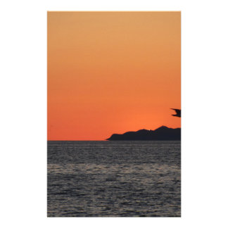 Beautiful sea sunset with island silhouette stationery