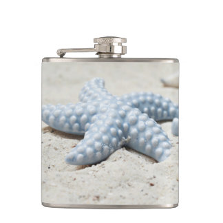 Beautiful summer beach sea star shell and sand hip flask