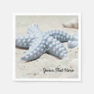 Beautiful summer beach sea star shell and sand paper napkin