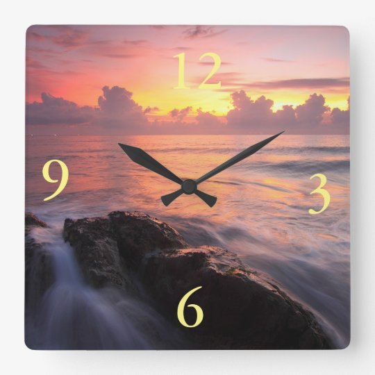 beautiful sunrise ocean clocks