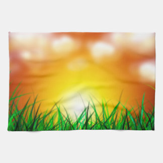 Beautiful Sunrise Over a Field of Grass Hand Towel