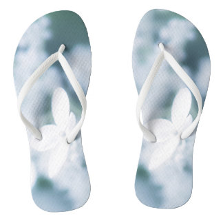 Beautiful white blossoms flip flops