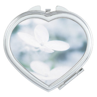 Beautiful white blossoms travel mirrors