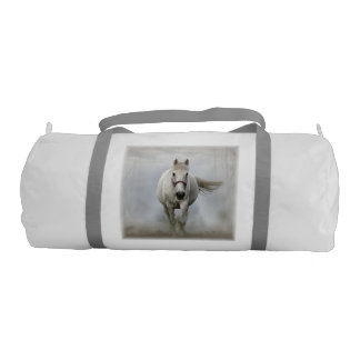 Beautiful white horse in mist gym bag