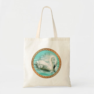 Beautiful white swan in a turquoise blue water tote bag