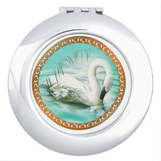 Beautiful white swan in a turquoise blue water vanity mirror