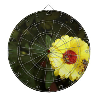 Beautiful yellow flower with small bee dart boards