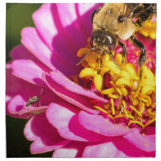 bee and bug standing on a purple flower napkin