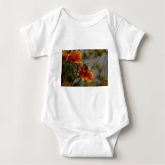 Bee foraging on a flower baby bodysuit